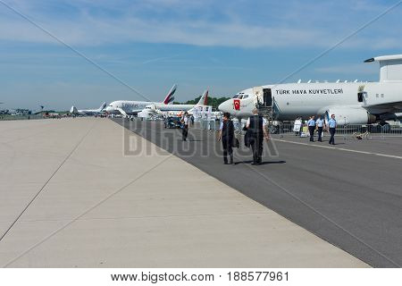 BERLIN GERMANY - MAY 21 2014: Passenger and military transport jet aircraft on the airfield. Exhibition ILA Berlin Air Show 2014