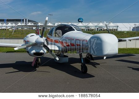 BERLIN GERMANY - MAY 21 2014: Airplane Diamond DA42 MPP Geostar. Exhibition ILA Berlin Air Show 2014