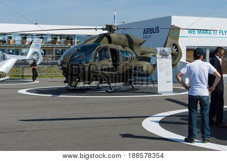 BERLIN GERMANY - MAY 21 2014: Army light utility helicopter Eurocopter EC645 T2 (Armed Scout 645). Exhibition ILA Berlin Air Show 2014