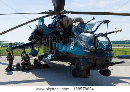 BERLIN GERMANY - MAY 21 2014: Attack helicopter with transport capabilities Mil Mi-24 Hind. Czech Air Force. Exhibition ILA Berlin Air Show 2014