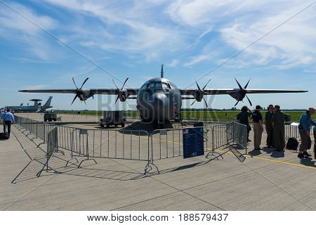 BERLIN GERMANY - MAY 21 2014: A four-engine turboprop military transport aircraft Lockheed Martin C-130J Super Hercules. US Air Force. Exhibition ILA Berlin Air Show 2014