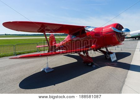 BERLIN GERMANY - MAY 21 2014: Utility aircraft Beechcraft Model 17 Staggerwing. Classic Flyers Team. Exhibition ILA Berlin Air Show 2014