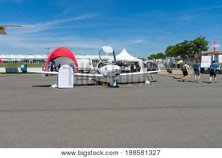 BERLIN GERMANY - MAY 21 2014: A German two seat side-by-side configuration light aircraft Aquila A211. Exhibition ILA Berlin Air Show 2014