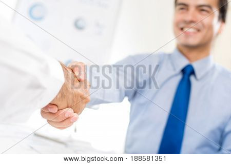 Businessmen making handshake - partnership greeting merger and acquisition concepts