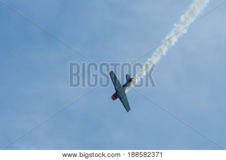 BERLIN GERMANY - MAY 21 2014: Demonstration flight of a single-engined advanced trainer aircraft North American T-6 Texan. Flying Bulls Team. Exhibition ILA Berlin Air Show 2014