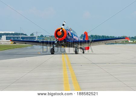 BERLIN GERMANY - MAY 21 2014: A single-engined advanced trainer aircraft North American T-6 Texan. Flying Bulls Team. Exhibition ILA Berlin Air Show 2014