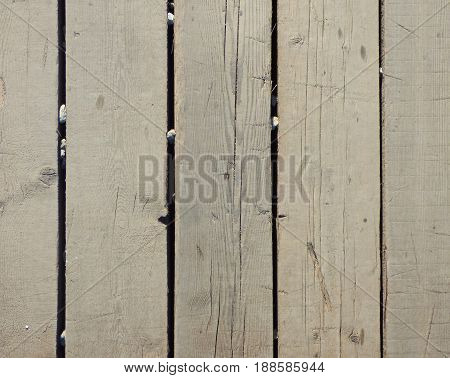 Old dirty board with some stones between them. Wooden texture with vertical structure. Abstract wood background with place for text.