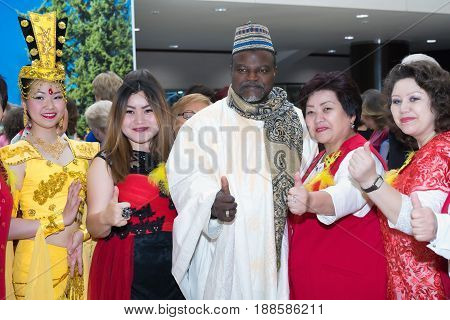 Moscow Russia - May 21 2017: Guests of the international conference of the FOHOW company in traditional costumes.