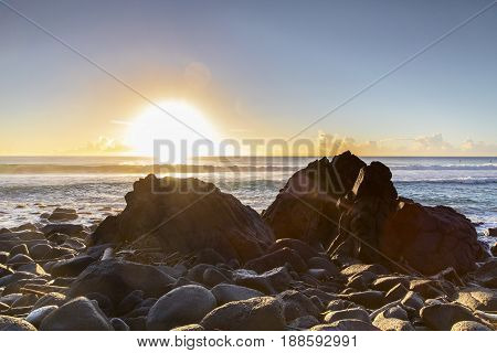 Sun rising over the ocean, view from the rocks at Burleigh Heads Gold Coast