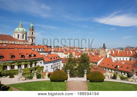 Panoramic view from the Vrtba Garden (Vrtbovská zahrada) to the ocher roofs of houses and the towers of the St. Nicolas Church Lesser Town (Malá Strana) Prague Czech Republic