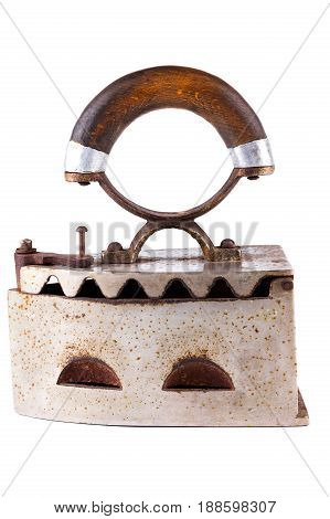 Old vintage metal iron with wooden handle isolated on white background.