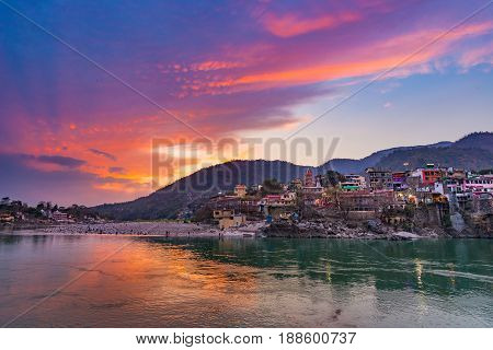 Dusk Time At Rishikesh, Holy Town And Travel Destination In India. Colorful Sky And Clouds Reflectin
