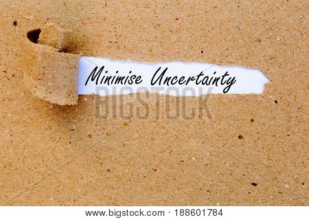 Minimise Uncertainty - printed text underneath torn brown paper