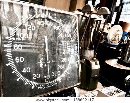 Close Up of Old Vintage Aneroid Sphygmomanometer Gauge Used to Measure Blood Pressure.
