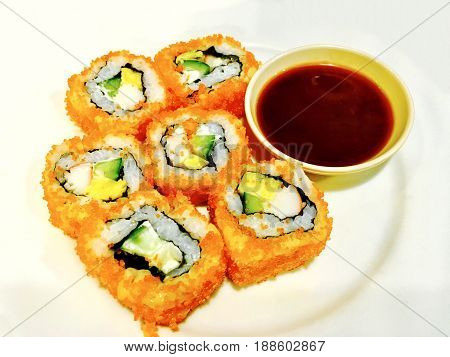 Japanese Cuisine Delicious Orange Ebiko California Roll Tobiko California Roll or Flying Fish Caviar California Roll Served with Wasabi and Soy Sauce.