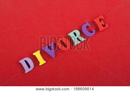 Word on red background composed from colorful abc alphabet block wooden letters, copy space for ad text. Learning english concept