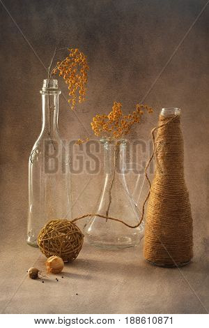 Mimosa in glass bottles and linen thread. Still life with mimosa.