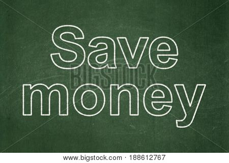 Money concept: text Save Money on Green chalkboard background