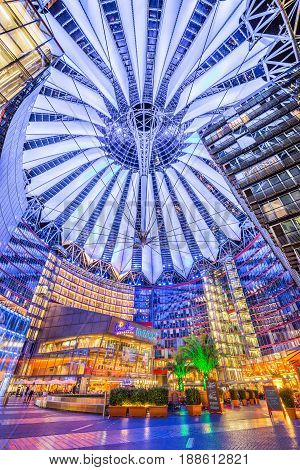 BERLIN - JULY 12: Famous Sony Center at Potsdamer Platz illuminated at night on July 24 2015 in Berlin Germany. The modern complex houses shops restaurants as well as Sony's European headquarters.