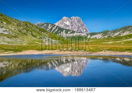 Beautiful landscape with Gran Sasso d'Italia peak at Campo Imperatore plateau in the Apennine Mountains Abruzzo Italy poster