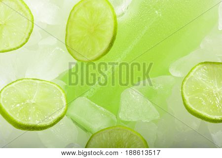 A Bottle Of Lemonade With Lime On Ice