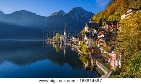 Scenic picture-postcard view of famous Hallstatt mountain village with Hallstatter See in the Austrian Alps in beautiful golden morning light in fall region of Salzkammergut Austria