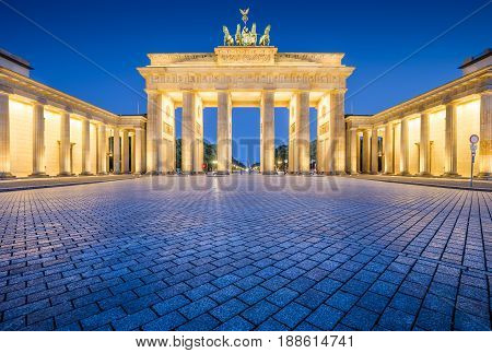 Panoramic view of famous Brandenburger Tor (Brandenburg Gate) one of the best-known landmarks and national symbols of Germany in twilight during blue hour at dawn Berlin Germany