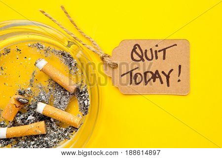 No Smoking - Time to Quit - with ashtray and handwritten tag on yellow background
