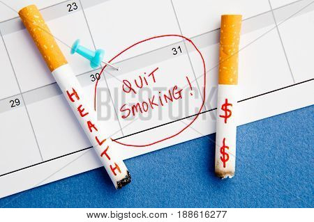 Quit Smoking - Calendar - Health and Money - with cigarettes on blue background