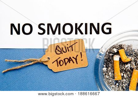 No Smoking  - Quit Today - with ashtray with printed words on blue and white background