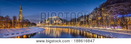 Panoramic view of the historic city of Salzburg with Salzach river in winter during blue hour Salzburger Land Austria