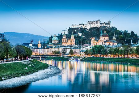 Beautiful view of Salzburg skyline with Festung Hohensalzburg and Salzach river at blue hour Salzburger Land Austria