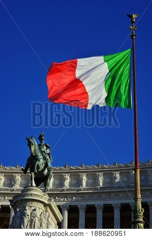 King of Italy looks at Italian Flag at the Altar of Nation monument in the center of Rome