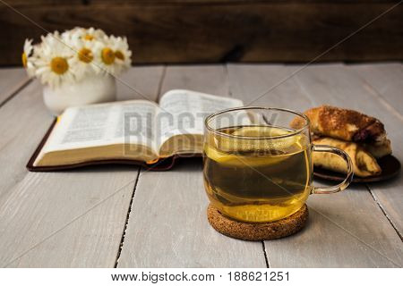 Bible And Tea On Wooden Background