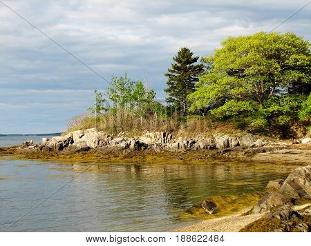 Rocky coast and beach on a Maine Island in Casco Bay.