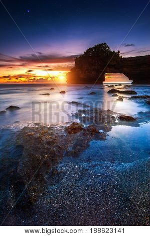 Tanah Lot Temple At Sunset In Bali, Indonesia.