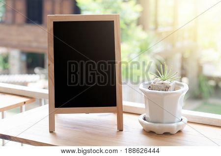 blank blackboard on terrace .Copy space concept.