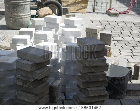 Square paving stones stacked for use in pedestrian crossing in village street in Andalusia