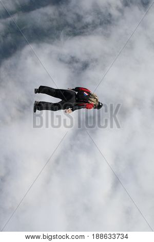 Skydiving over beautiful Norway. Clouds, sun and skydiving