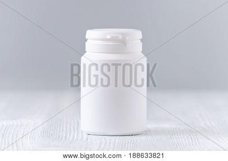 mock up plastic bottle for medicine, powder, pills, tabs, capsules on gray background