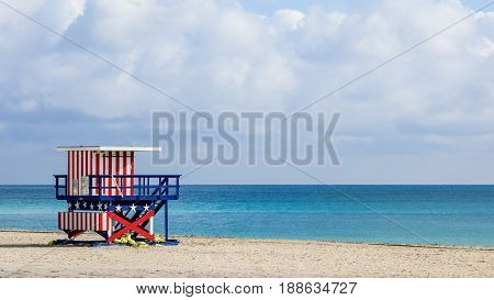 Colorful lifeguard tower in empty South Beach Miami Beach Florida USA on a cloudy day.
