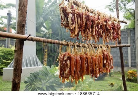 Thai People Cooking Grilled Sun-dried Beef And Pork Recipe On Local Stove Thai Style