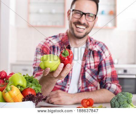 Man Showing Vegetables In Kitchen