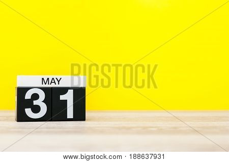 May 31st. Image of may 31 calendar on yellow background. Last spring day, Spring end. Empty space for text. World blondes Day.