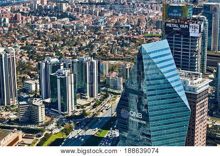 Istanbul, Turkey - April 3, 2017: Arial view the Levent Business District. Shooting through the glass. Retro style