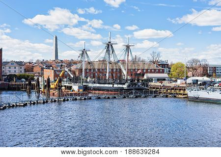 Ship at Charlestown peninsula and Bunher Hill Monument on the background in Boston MA the United States.