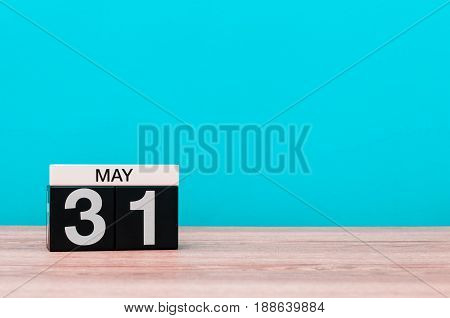 May 31st. Day 31 of month, calendar on turquoise background. Spring time, empty space for text.