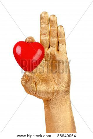 Man's golden hand with a red heart over white background. Element for romantic holiday designs and for healthcare, medicine and World Blood Donor Day. Red Heart and Hand isolated on white