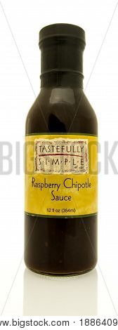 Winneconne WI - 16 May 2017: A bottle of Tastefully Simple raspberry chipotle on an isolated background.