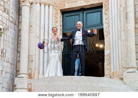Bride And Groom At Doorway Of Church In Dubrovnik